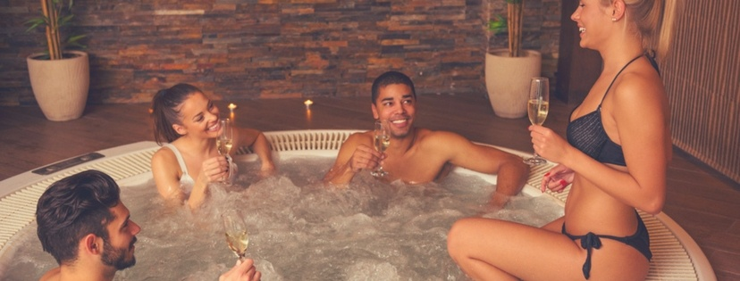 Friends relax at 4 Person Hot Tubs