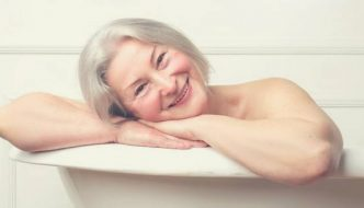 Happy old woman with best bathtubs