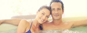 Happy time couple relax with inflatable hot tub