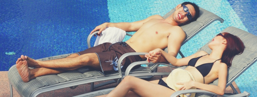 A couple enjoy with pool chairs