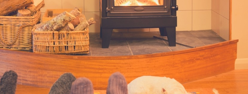 Happy family enjoy wood burning stove at winter