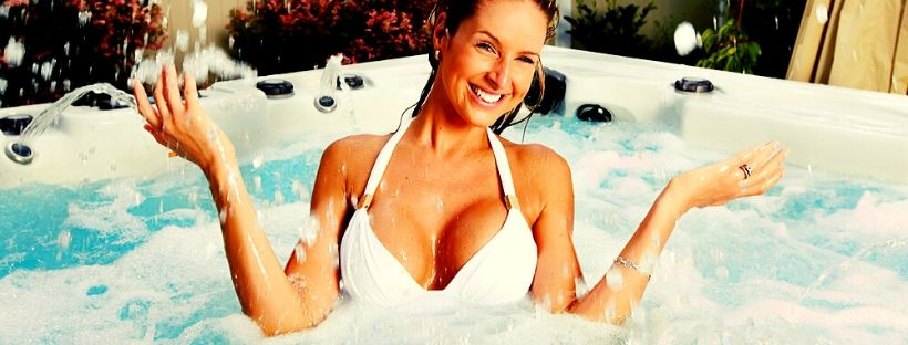 woman soaking in the best outdoor hot tubs